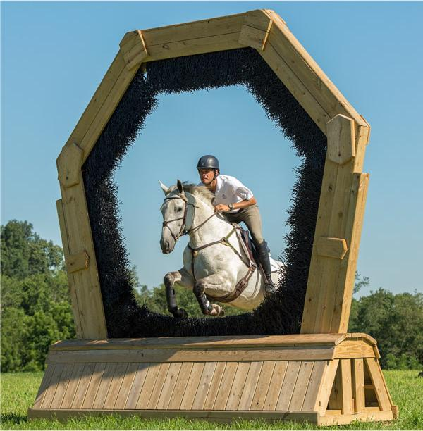 Horse going through keyhole jump
